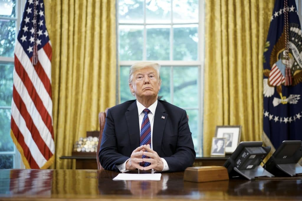 President Donald Trump in the Oval Office discussing the trade deal.